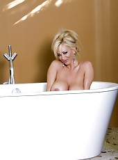 Beautiful busty blonde, Rachel Aziani, is a dream bathing in the nude in her outdoor tub and posing for the camera!