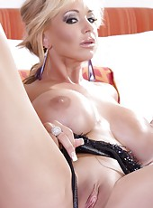 Beautiful busty blonde, Rachel Aziani, looks smoking hot in her sexy black teddy, heels, and playing with her big naughty dildo!