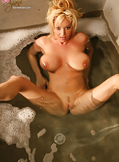 Busty Rachel Aziani enjoys her hot bubble bath, pouring water of her hard nipples and flawless curves.