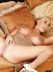 Beautiful blonde pornstar, Mary Carey, is all dolled up in her pretty dress.  She loves the easy access it gives her to pop out her big boobs and show off her smooth pussy.