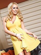 A bright yellow dress and no panties makes for a hot shoot with busty blonde pornstar, Mary Carey.