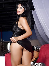 Priya Anjali Rai in her black leather zip up dress exposes her giant tits and red hot panties.