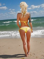 Hot petite blond milf at the beach sexy body yellowe bikini