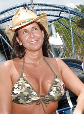 This hot milf is getin down and dirty in these hot airboat fuck pics