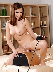 Sexy babe riding the sybian hard
