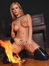 Nude blonde babe plays with fire