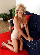 65 year old housewife Kamilla putting on a very sexy strip show here