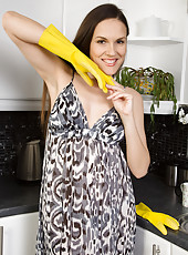 Tall brunette housewife Tea from AllOver30 gets wet in the kitchen