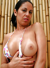 This hot brazilian mamma takes gets it all in these hot pics