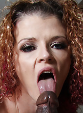 Sexy redhead milf Joslyn James in stockings fucking with black guy