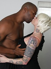 Tattoed blonde mom Monroe Valentino in hot interracial sex scene