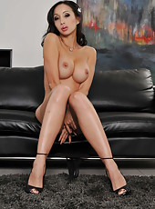 Beautiful brunette milf Katsuni shows her pussy and sweet boobs