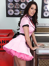 Passionate brunette girl Kortney Kane undresses her sexy pink dress
