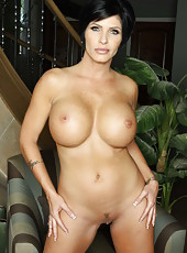 Sexy short haired brunette milf Shay Fox shows off her unforgettable huge tits and pretty pussy
