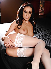 Wavy haired brunette babe Breanne Benson spreads her legs in sexy stockings