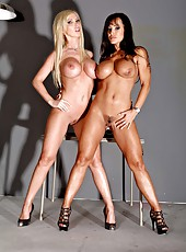 Two first-class milfs brunette Lisa Ann and blonde Nikki Benz posing on camera