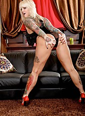 Tattooed bombshell Janine Lindemulder shows her big tits and spreads her butt