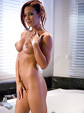 Sexy redhead milf Ryder Skye enjoys hot bathing with her sweet pussy and big tits