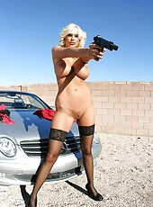 Dangerous blonde milf Puma Swede undresses and shows her huge boobs