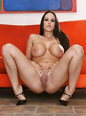 Luxury brunette with sexy straight hair Carmella Bing demonstrates her ultimate boobs
