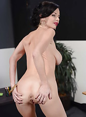 Elegant brunette with sexy red lipstick Veronica Avluv poses in the classroom