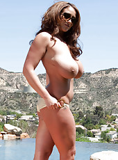 Appetizing wavy haired milf Eva Notty makes water in the pool hot