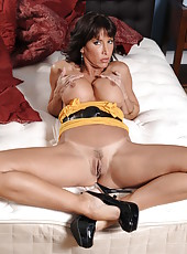 Mesmerizing milf Lezley Zen takes off her jeans, panties and poses in sexy high heels