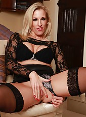 Extremely hot blonde milf Rebecca Moore poses and teases in super sexy lingerie
