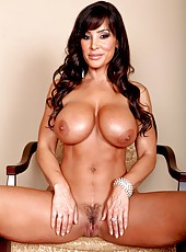 Well-known milf Lisa Ann showing big tits and posing in hot panties