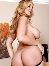 Happy babe Julia Ann taking off lingerie and showing big tits on camera