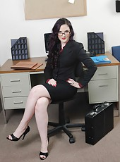 Tough babe Caroline Pierce shows shaved pussy and fingers it in her office
