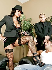 Winning whore Lisa Ann posing in stockings and pleasing her new boss