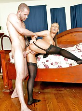 Arresting milf Phoenix Marie posing in stockings and making a deepthroat