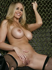 Cute babe Julia Ann taking off red lingerie and working with big tits