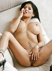 Naive pornstar Alexis Amore shows sexy tattoo and masturbates on camera