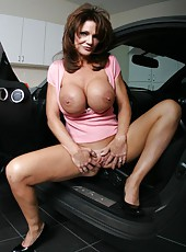 Mature whore Deauxma demonstrating juicy melons and tight shaved pussy