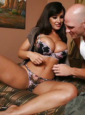 Tight cunt of the dark haired milf Lisa Ann is being fucked hard by a big cock