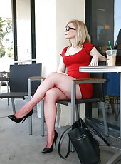 Nina Hartley is enjoying being filmed on camera in her red dress