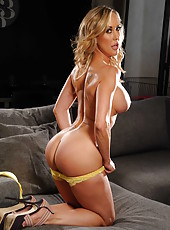 Beautiful blonde lady Brandi Love demonstrates her delicious boobs