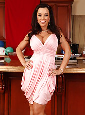 Nasty slut Lisa Ann takes of her sexy clothes and masturbates in the kitchen