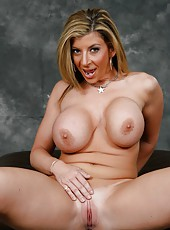 Fatty milf with huge ass and giant tits Sara Jay strips with hot smile on the face