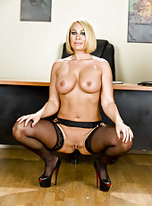 Short haired blonde milf with great big tits Mellanie Monroe strips in the office