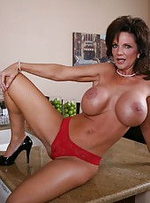 Horny brunette mommy named Deauxma demonstrates her huge boobs