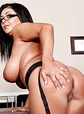 Black haired cougar Jaylene Rio shows off her huge natural boobs and sexy ass