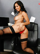 Brunette milf Isis Love is tired of dull work and decided to strip in the office