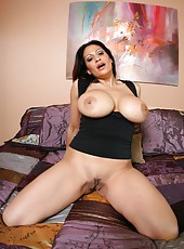Mature lady Ava Lauren willingly poses with naked big tits and shaved pussy