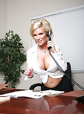 Elegant blonde milf Diamond Foxxx shows her gorgeous body in the office