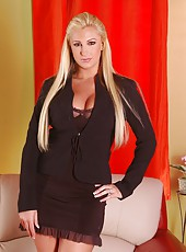 Beautiful blonde lady Emilianna undresses her black lingerie and masturbates