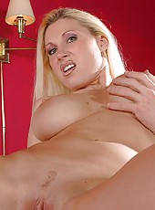 Crazy hot and all natural milf with great breast Devon Lee poses naked on the camera