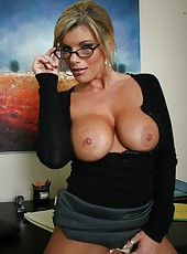 Fabulous milf in sexy glasses Kristal Summers shows off her sexy forms in hot stockings